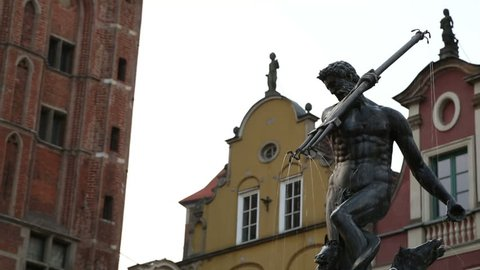Sculptures adorning fountain in city, statue of Poseidon holding trident, Gdansk