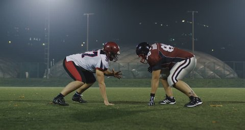 American football player tackles opponent