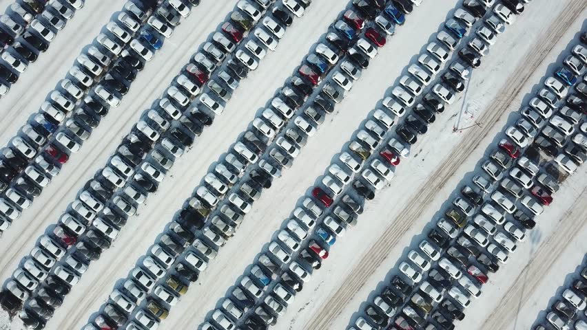Aerial view of new car storage parking. Car industry.Market for sales in winter. | Shutterstock HD Video #1007521351