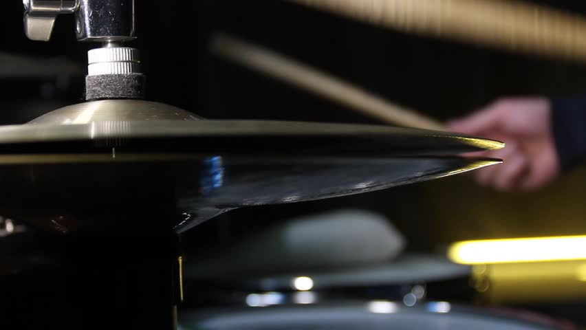 Close up of drum plate hi hat and a drummer playing on drums. Slider shot.   Shutterstock HD Video #1007524000