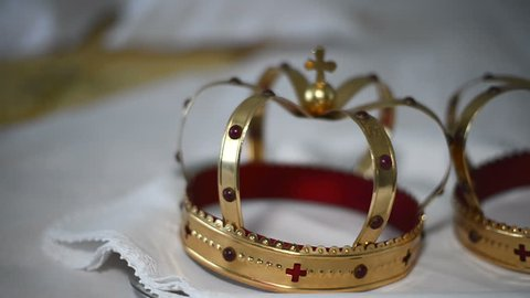Church attributes for wedding ceremony. Gold crowns are on the altar