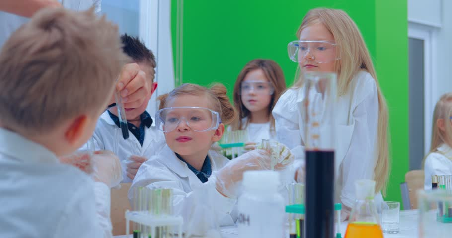 Teacher and students doing science experiment in school classroom. Children in chemistry class | Shutterstock HD Video #1007553394