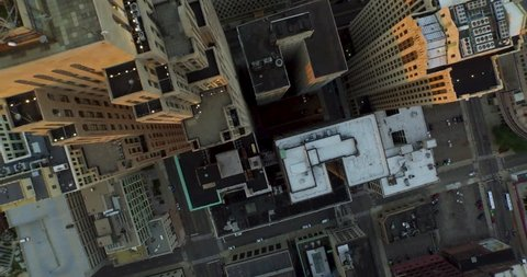 Detroit Aerial - Straight down flyover rooftops and the streets of a busy hard working city.