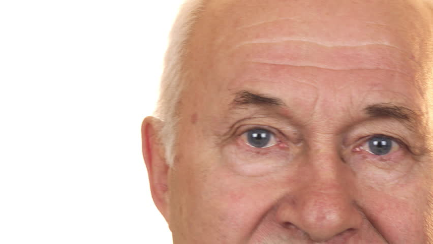 Close up of the blue eyes of a cheerful senior man isolated