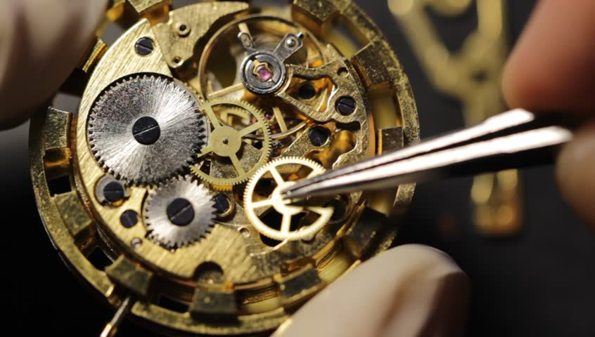 Watchmaker is repairing the mechanical watches in his workshop | Shutterstock HD Video #1007575270