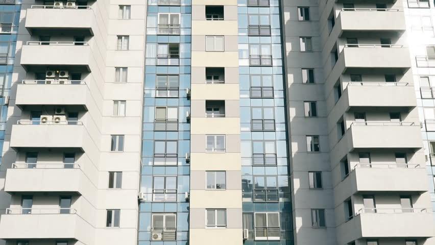 Facade of a modern apartment building, abstract apartment building establishing shot. living block of flats