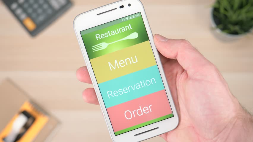 Ordering food online from a restaurant with a smartphone device.