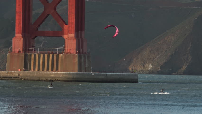 Kiteboarding at Golden Gate Bridge. Constant Wind makes the waters around San Francisco's Golden Gate Bridge a perfect Wind Surfing location
