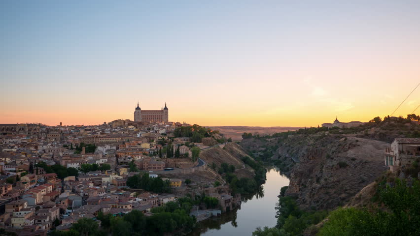 Beautiful time lapse of the Toledo old town cityscape at the Alcazar in sunrise time, Spain
