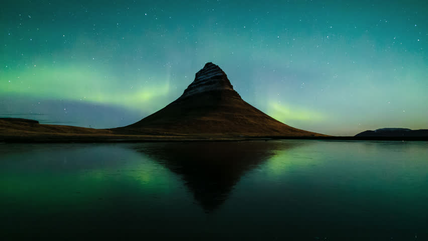 4K Time lapse of Aurora Borealis (Northern lights) over Kirkjufell mountain, Iceland  | Shutterstock HD Video #1007628460