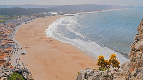 Seaside resorts in Atlantic coast picturesque Nazare in Portugal. View of Nazare Skyline and beach