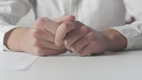 Close up of Adult man hand finger tapping on table. Waiting for something