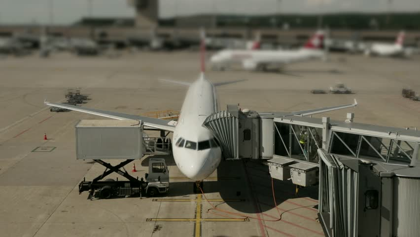 Overlooking International Airport Terminal. Airplanes Preparing for Flight | Shutterstock HD Video #1007649190