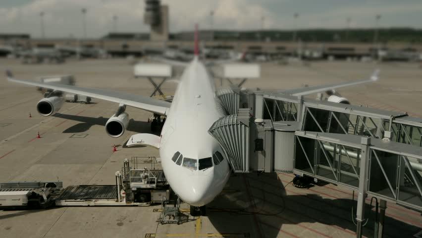 Overlooking International Airport Terminal. Airplanes Preparing for Flight