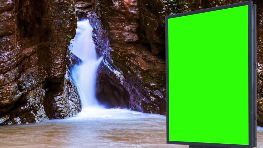 Billboard green screen near the Fabulous waterfall   Shutterstock HD Video #1007703973