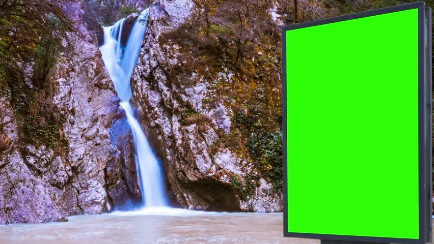 Billboard green screen near the Fabulous waterfall   Shutterstock HD Video #1007704006