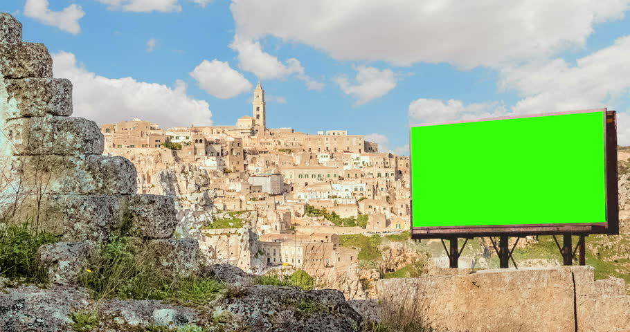 Empty billboard with chroma key green screen, panoramic view of typical stones (Sassi di Matera) and church of Matera, European Capital of Culture 2019, Italy, time-lapse, advertisement concept   Shutterstock HD Video #1007706514