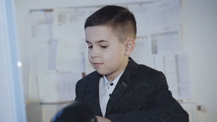 Handsome little boy plays computer game and rejoices from win. 4K.   Shutterstock HD Video #1007712355
