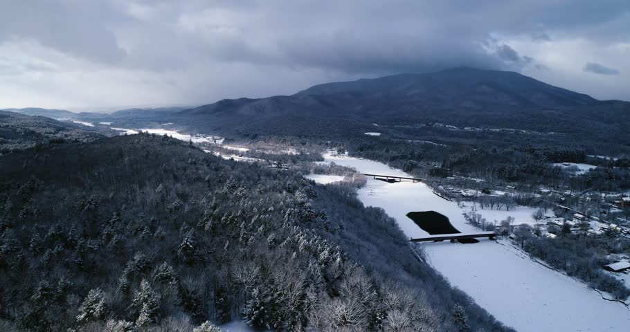 Flying along the Connecticut River in New England after a snowstorm