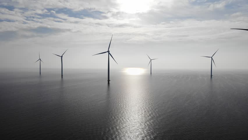 Offshore Windmill farm in the ocean  Westermeerwind park , windmills isolated at sea on a beautiful bright day Netherlands Flevoland Noordoostpolder, Drone view from above out the sky bird eye view