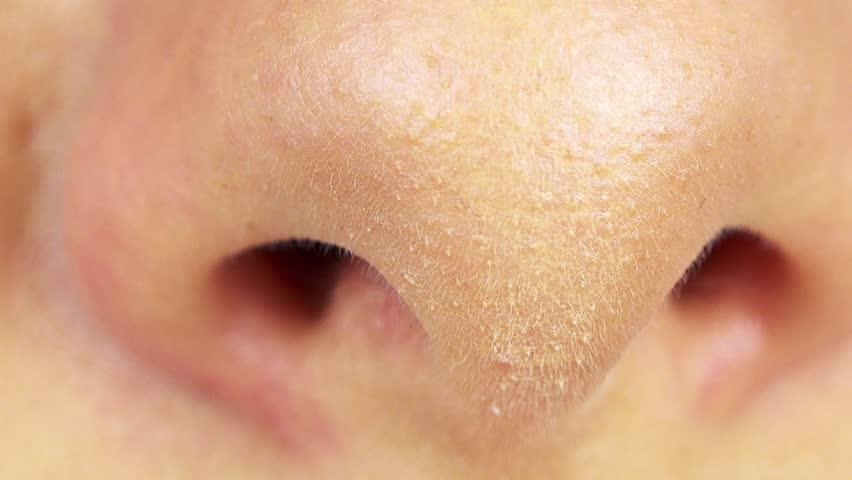 A woman breathes through her nose - closeup | Shutterstock HD Video #1007824510