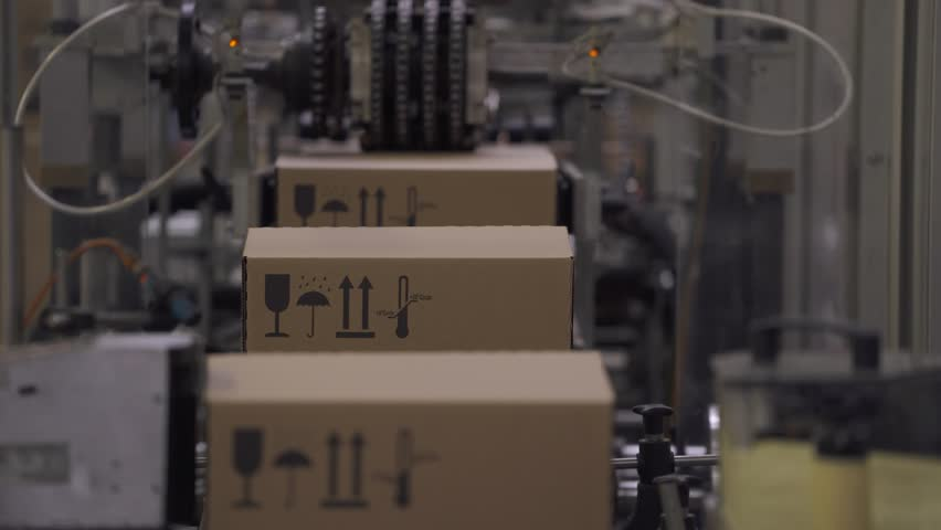 Warehouse, cardboard box is moving along the production line. | Shutterstock HD Video #1007825980