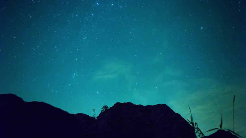 Timelapse - Rivers, mountain stars, zodiacal light and the Milky Way on a beautiful blue night in New Day. Video. Stone lake with night sky, time lapse. Stone river With starry milky way galaxy | Shutterstock HD Video #1007853730