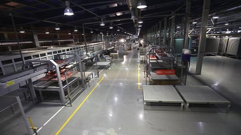 Industrial interior of a modern factory, Manufacturing Plant, AGV transports products, Electrical Automated Guided Vehicles Platform, Automatic stacker, AGV,