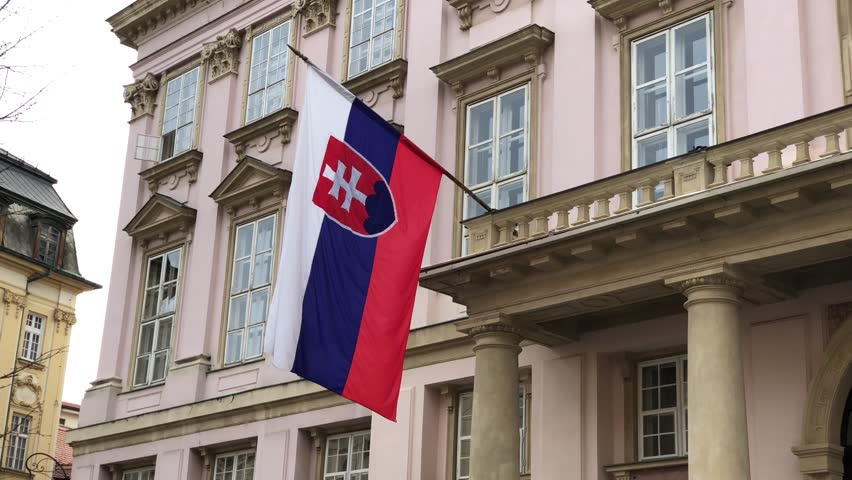 Flag of Slovakia waving in the wind on the building of City Hall in Bratislava, Slovakia
