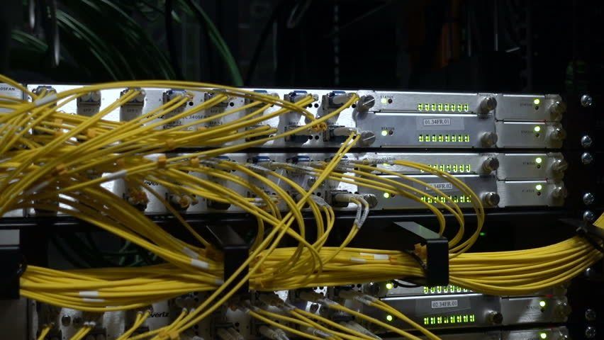 Optical server. Commutator. flashing lights. Optical fiber. Video IP Gateways. Audio. Severs computer in a rack at the large data center. Rack Mounted Servers. big data