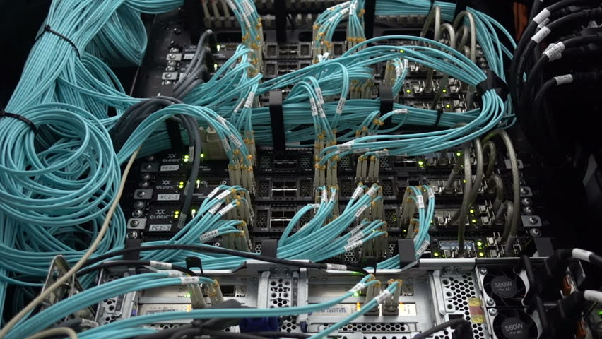 Optical server. Commutator. flashing lights. Optical fiber. Video IP Gateways. Audio. Severs computer in a rack at the large data center. Rack Mounted Servers. big data telecommunications