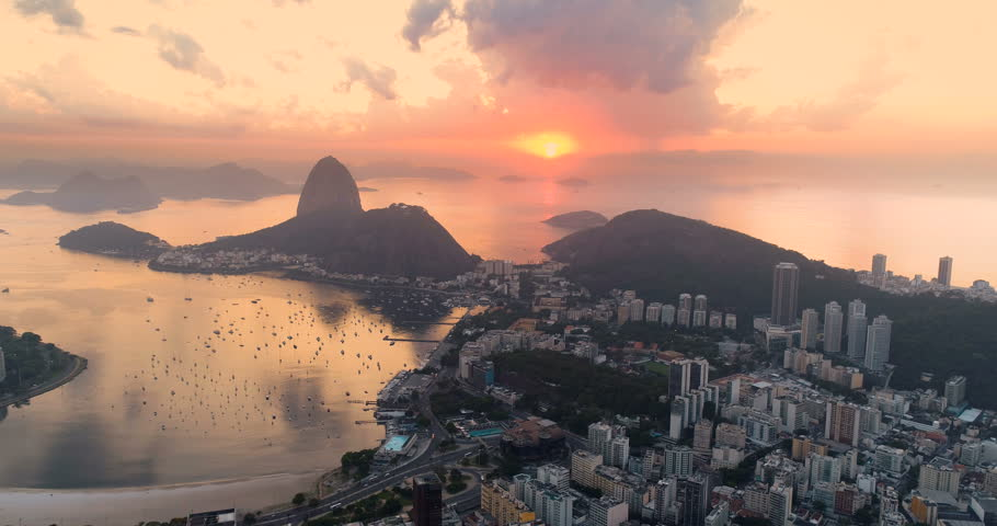 Aerial above Botafogo Bay at sunrise, Rio de Janeiro, Brazil. Orange sun above the ocean | Shutterstock HD Video #1007918740