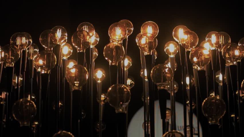 Inspiring and futuristic concept of performance using light bulbs as symbol of ideas and creativity of science and technology. Vintage tungsteen bulbs light up darkness | Shutterstock HD Video #1007936860