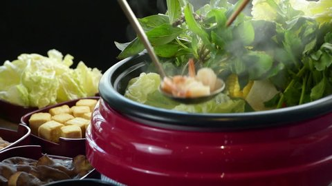 enjoy eating Shabu Shabu and Sukiyaki in hot pot at japanese restaurant. Sukiyaki is healthy food for diet, a lot of vegetables. It is popular dish not only in Japan but all of asian people love it