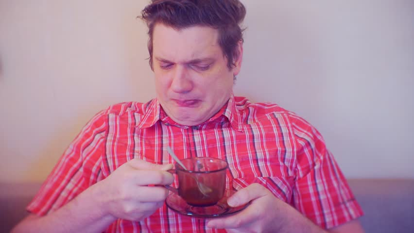 portrait of a man with a cup of coffee which was not pleasant