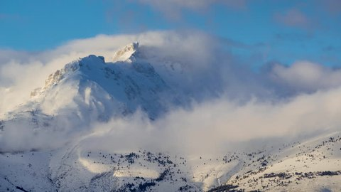 Winter timelapse between sunset and twilight of Bure Peak (Pic de Bure) in the Devoluy Massif. Hautes-Alpes, French Alps, France