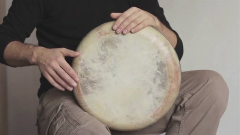 Man musician plays ethnic handmade drum darbuka close up. Male hands tapping djembe bongo hands movement rhythm. Musical instruments world culture sound