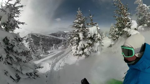 360 OVERCAPTURE SELFIE 3D: Extreme snowboarder has fun riding fresh powder snow off piste in white mountains. Pro rider snowboarding and carving freshly fallen snow in mountain wilderness. Fun effects