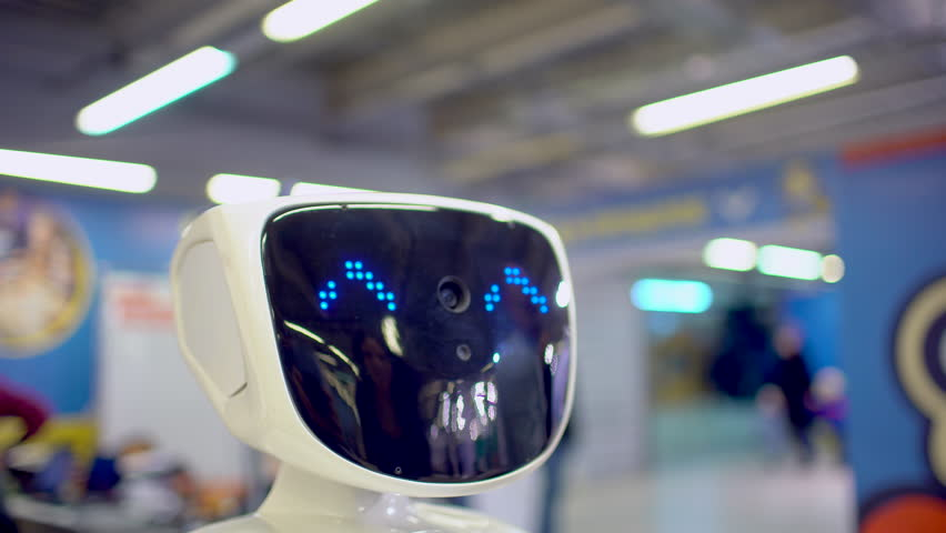 Close up of robot head. Robots emotions. The robot looking at camera at person. robots Modern Robotic Technologies. Modern Robotic Technologies. love. heart. artificial intelligence, virtual, vr 4 k | Shutterstock HD Video #1008006460