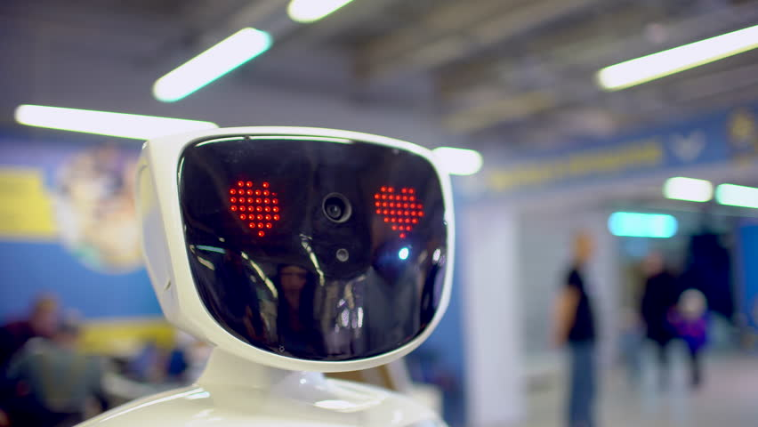 Close up of robot head. Robot emotions. The robot looks at the camera at the person. Modern Robotic Technologies. Modern Robotic Technologies. love. heart. artificial intelligence, virtual, vr 4 k