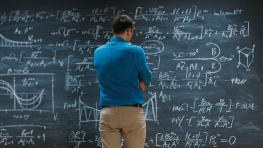 Brilliant Young Mathematician Approaches Blackboard and Finishes Solving Long and Complex Equation. Shot on RED EPIC-W 8K Helium Cinema Camera.