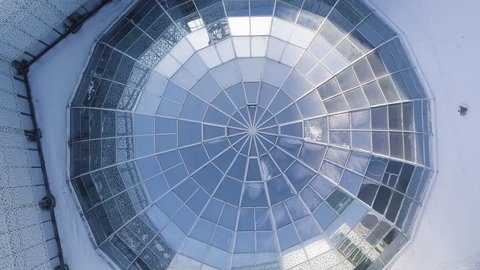 Top view on Structural glass facade curving roof of fantastic office building.