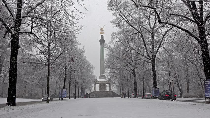 MUNICH / GERMANY - FEBRUARY 17 2018 : The Angel of Peace on the top of Friedensengel monument in Munich, Germany during the snow srorm.