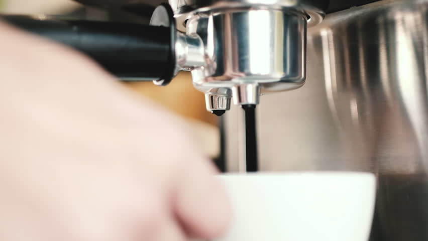 Slow motion camera on dolly / track. Making coffee at home or in a small coffee shop. Close-up, counter-light, low depth - film depth of field.   Shutterstock HD Video #1008137680