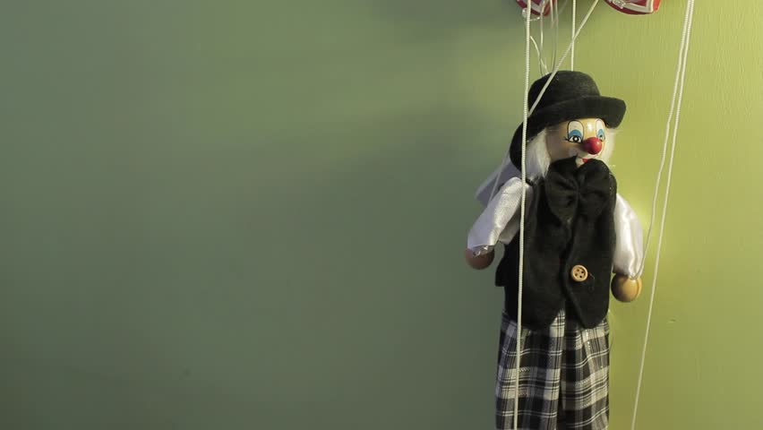 Wooden Clown Puppet Dummy Marionette on the Wall Hanging with Ropes Full HD Footage