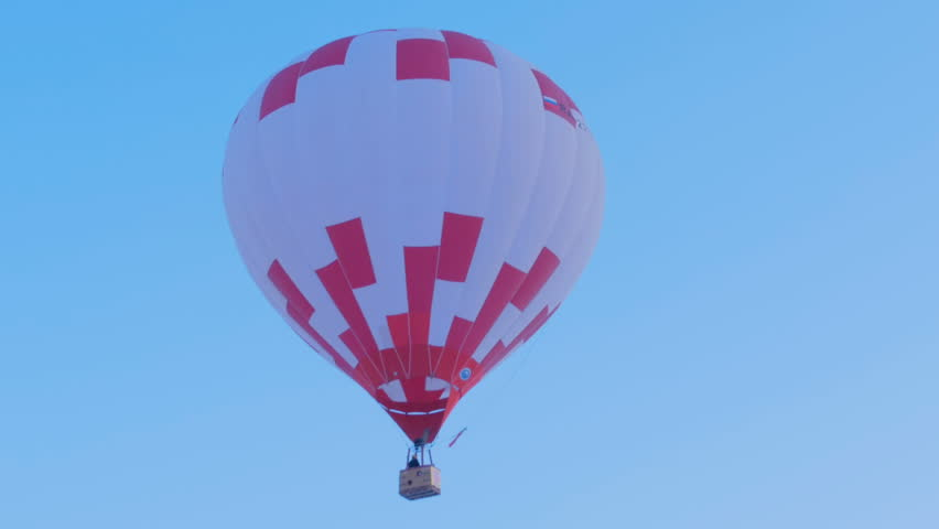 Hot air balloon takes off against the blue sky