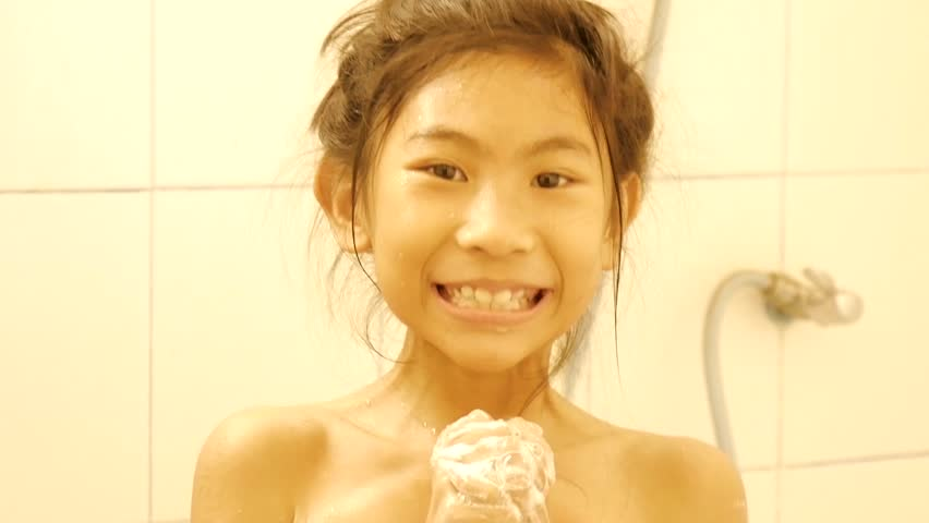Happy girl plays bubbles while taking a shower. | Shutterstock HD Video #1008147010