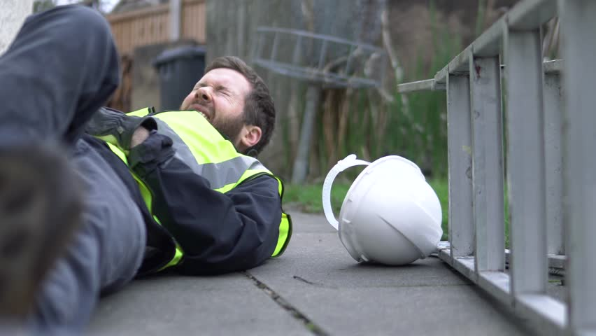 Injury At Work, A Man Falls Off Ladder Is Injured, Compensation Accident Claim. Man On Floor Outside In Back Pain. | Shutterstock HD Video #1008238120