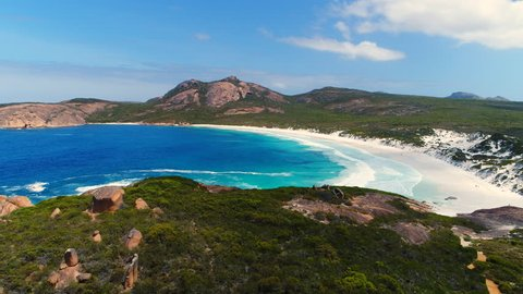 Aerial view of picturesque beach scenery of Hellfire Bay, colorful cliffs and rocks above crystal clear waters of Southern Ocean - Cape Le Grand, Esperance, Western Australia from above, 4k UHD