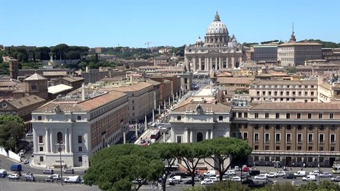 Aerial view of busy Rome city streets showing in background Vatican City St. Peter's Basilica buidling the Italian Renaissance church in Vatican City the papal enclave within the city of Rome Italy 4k